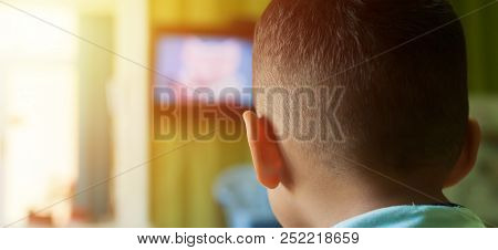 Small Boy On The Couch Watching Tv. Little Boy Watching Cartoons On Tv