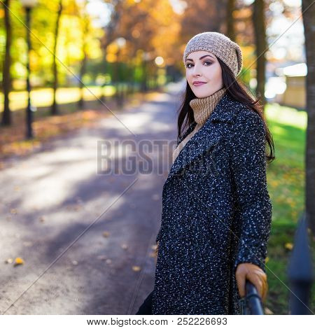 Portrait Of Attractive Woman Posing In Autumn Park
