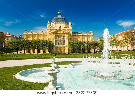 Zagreb, Croatia, Art Pavilion And Fountain In Beautiful Spring Day, Colorful 19 Century Architecture