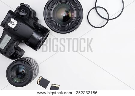 Photography Equipment And Copy Space Over White Table Background