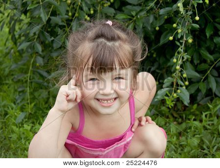 The Little Girl Turns Finger To His Temple