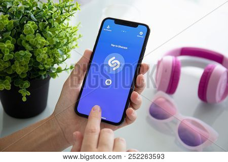 Alushta, Russia - July 27, 2018: Woman Hand Holding Iphone X With Music Service Shazam On The Screen