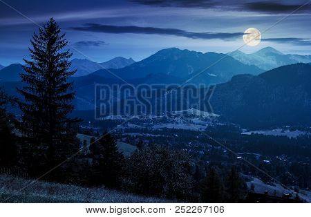 Beautiful Landscape Of Zakopane Valley At Night In Full Moon Light. Popular Tourist Destination In H