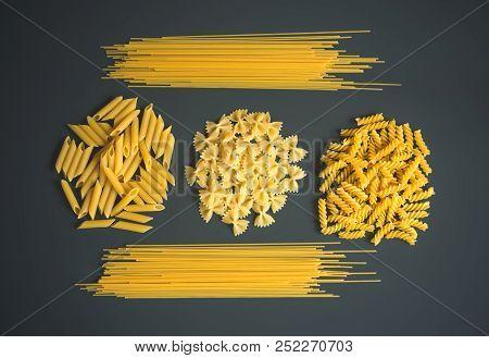 Raw Pasta Spaghetti, Farfalle, Fusilli And Penne On Dark Background.