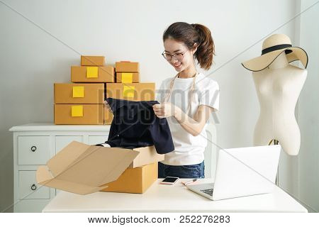 Online Small Business Owner, Young Business Start Up Online Seller Owner Using Computer For Checking