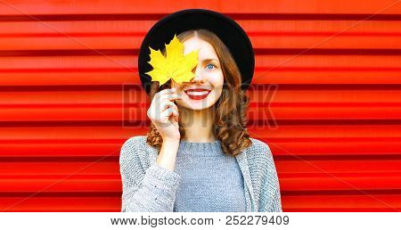 Happy Cool Girl  Hides One Eye Yellow Maple Leaf On A Red Background