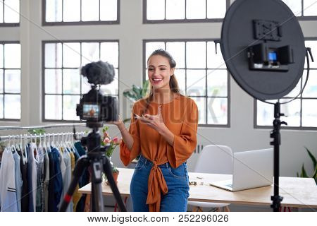 Social influencer creating online content for her channel, daily vlog
