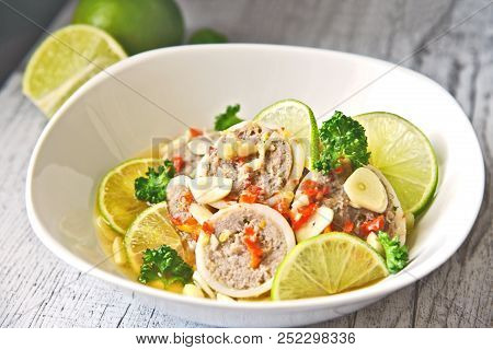 Steamed Filled Squid In Lime Sauce (thai Name Is Pla Muk Nung Manow). Squid And Minced Pork  Homemad