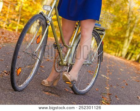 Woodland Forest Fall Outdoor Fitness Concept. Girl In Dress On Bike. Young Lady In Elegant Clothes I