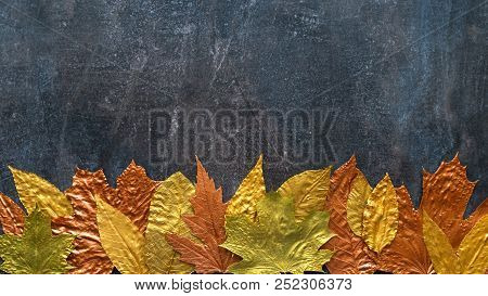Autumn Metallic Gold Copper Leaf Frame. Different Fall Metallic Paint Leaves On Dark Natural Backgro