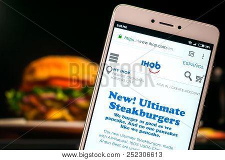 Kropivnitskiy, Ukraine - 8 July, 2018: Ihop  Website On Mobile Screen On Blurred Burger Background.