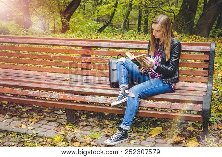 Beautiful Teen Girl Reading A Book. Teenage Or Young Adult High School Or College Student Studying I
