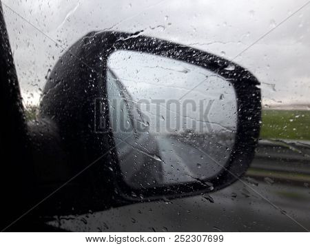 Low Visibility On The Highway During Storm. Water Drops On The Window Affect The Visibility In The R