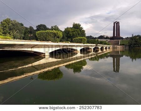 Heroes Monument Reflecting In The Lake. The Carol Park Mausoleum Mausoleul Din Parcul Carol Was Buil
