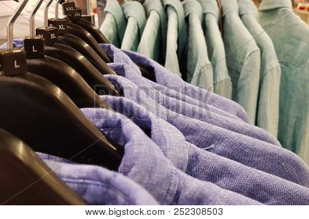 Men's Blue Colored Shirts On The Vases At The Retailer.