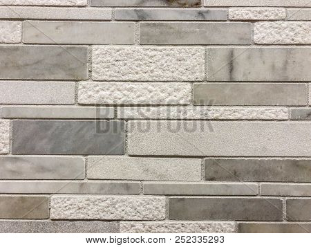 limestone tiles made of natural stone for interior kitchen. Modern grey paint limestone texture background in white light seam home wall paper. Back flat subway concrete stone table floor concept surreal granite quarry stucco surface background grunge pat