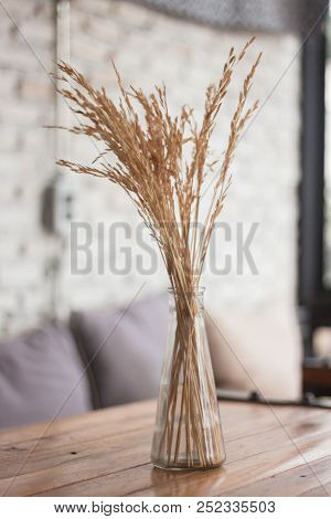 Bouquet Of Dried Flowers In Vase On Table, Stock Photo