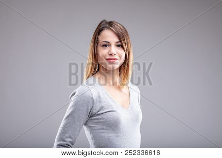 Smiling Young Woman With Brown Hair Wearing Shirt