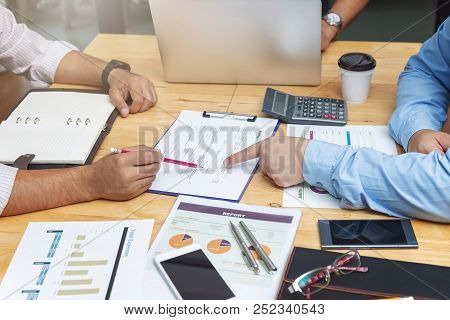 Business And Finance Concept Of Office Working,top View Of Teamwork Of Businessmen Discussing Busine