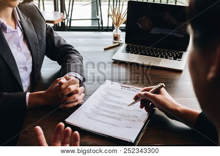 Job Interview In Office, Employer Reviewing Good Cv Of Prepared Skilled Applicant, Recruiter Conside