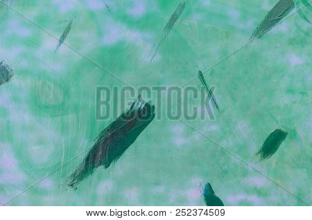 Light Green Painted Surface With Smears Of Dark Green Paint On Top Of It. Abstract Background Of Old