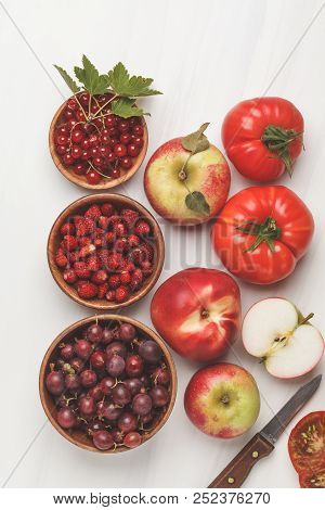Assortment Of Red Foods On A White Background, Top View. Fruits And Vegetables Containing Lycopene.