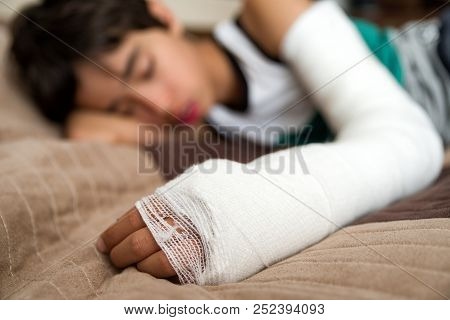 Sleeping Boy With Broken Hand In Cast.