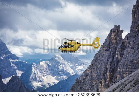 Panoramic Flight Over The Mountains. Air Transport. Helicopter Flight Over The Epic Landscape. Rescu
