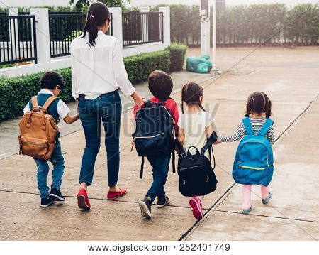 Children Kid Son Girl And Boy Kindergarten Walking Going To School Holding Hand With Mother Mom