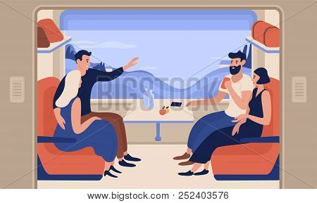 Young Smiling Men And Women Travelling By Train. Cheerful People Sitting In Passenger Car And Talkin