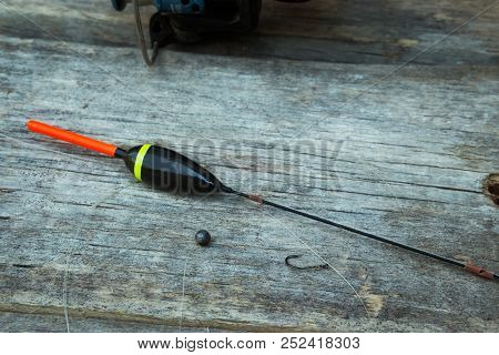 Fishing Tackle, Float, Fishing Line, Sinker And Hook On Old Wooden Boards