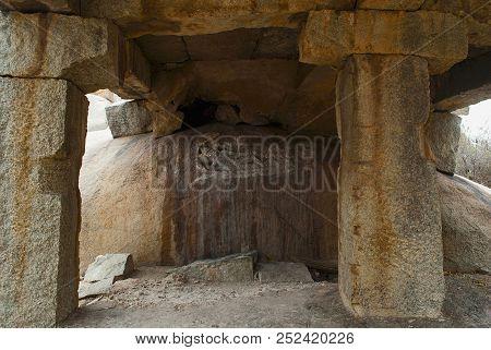Ruins of Vishnu temple located on the path from the eastern gateway of Hampi Bazaar to the Achyuta Raya temple, Hampi, Karnataka. Sacred Center. poster