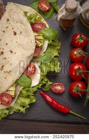 Italian Piadina Romagnola Flatbread With Lettuce, Cherry Tomatoes, Prosciutto Ham, Mozzarella Cheese