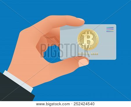 A Man S Hand Holds A Bitcoin Debit Card. Account, Credit, All In One Card Concept For Bitcoin. Payin