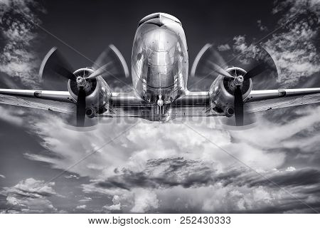 Black And White Picture Of Anhistorical Aircraft Against A Cloudy Sky