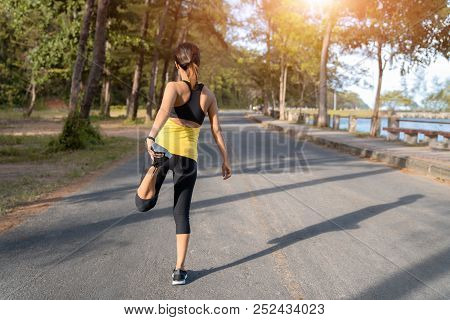 Young Fitness Woman Runner Stretching Legs Before Run On City, Young Fitness Sport Woman Running On