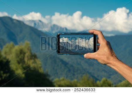 Hand Making Photo With Smartphone Camera Closeup, View Tourist Hands Using Gadget Phone In Travel On