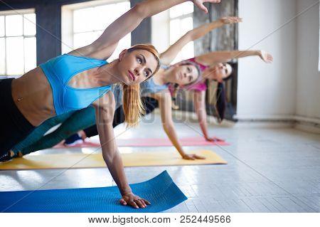 Group Workout, Women Fitness Class, Active Lifestyle, Health, Teamwork. Sporty Women Doing Side Plan