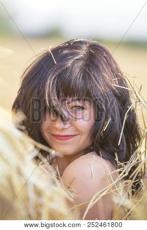 Portrait Cute Happy Beautiful Female Brunette With Red Lipstick Against A Background Of Wheat Field