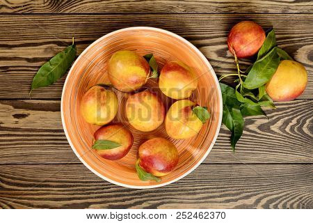 Many Juicy Beautiful Amazing Nice Peaches On Dark Wooden Background. Beautiful Food Art Background.