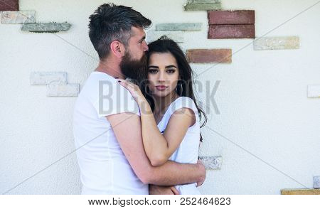 Tender Hug. Couple In Love Romantic Date Cuddling Outdoors Light Wall Background. Man Bearded And Gi