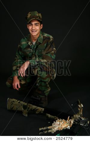 Teen Boy With Crossbow