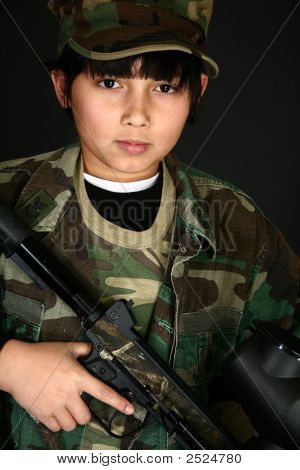 Boy With Paintball Rifle