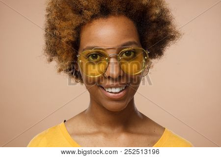 Closeup Headshot Of Good-looking African American Lady Pictured Isolated On Beige Background Looking