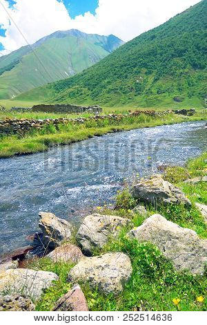 Landscape With Mountains, River In Front. Beautiful Scenery. Mountain River Valley Landscape. River