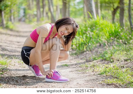 Port Woman With Ankle Injury In The Forest