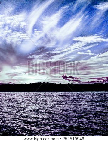 Beautiful Peaceful White And Lilac Cirrus Cloud Sunset Seascape Over Calm Reflective Ocean Waters Wi