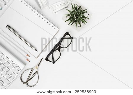 Above View Of Office Supplies With Copy Space On White