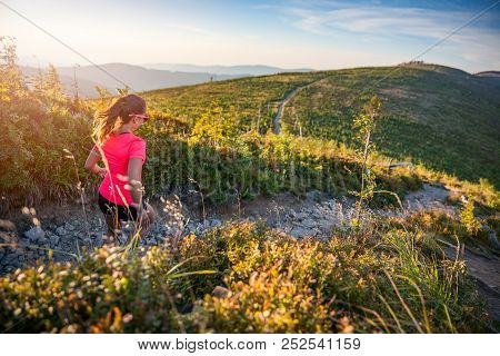 Beautiful Young Woman Running In Mountains.