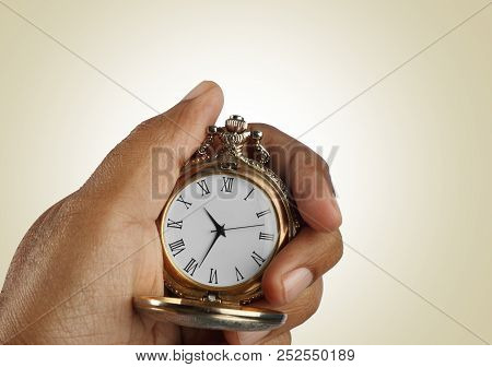 Old Golden Antique Watch In A Hand Isolated